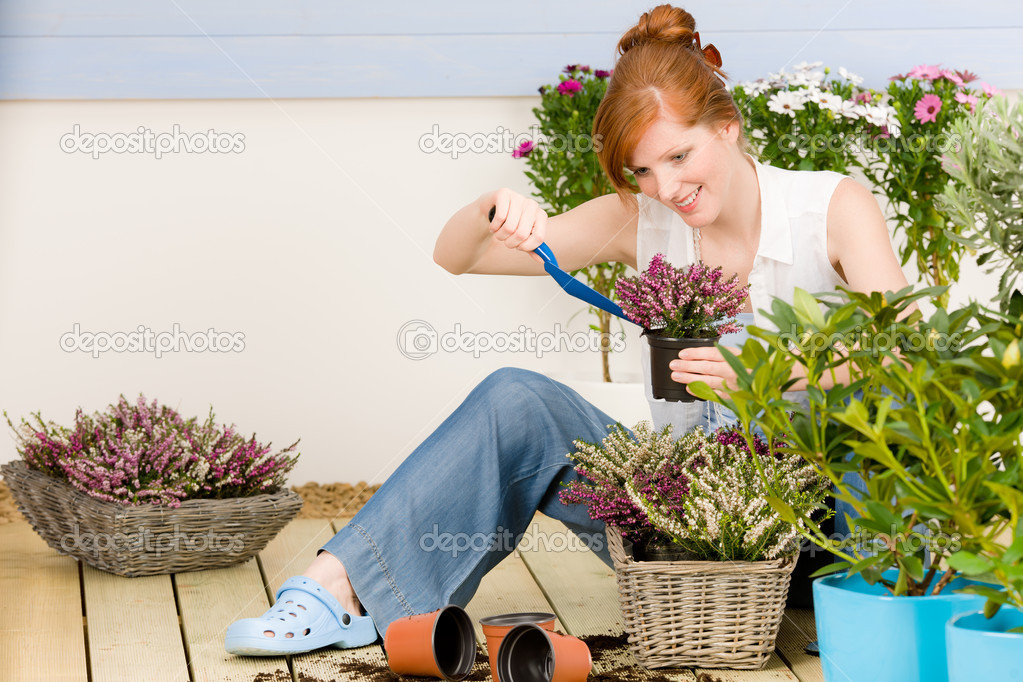 Summer garden terrace redhead woman hold potted flower  Stock Photo #5572966