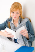 Student young happy woman portrait with book — Stockfoto