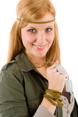 Hippie young woman in khaki outfit hold dog-tag — Stock Photo