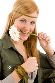 Hippie young woman hold gerbera daisy — Stock Photo