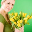 Young woman hold yellow tulips flower — Stok fotoğraf