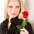 Elegant sexy woman hold red rose — Stock Photo #5657378
