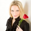 Elegant woman hold red rose — Stock Photo #5657380
