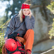 Active woman rock climbing with backpack — Stock Photo