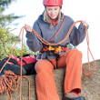 Stock Photo: Active womrock climbing holding rope
