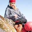 Active woman rock climbing relax with backpack — Stock Photo #5657441