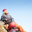 Active woman rock climbing relax with backpack — Stock Photo #5657451