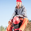 Stock Photo: Active womrock climbing relax with backpack