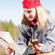 Active woman backpack search navigation map — Stock Photo #5657467