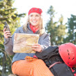 Active woman backpack search navigation map — Stock Photo #5657472