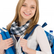 Student teenager woman with schoolbag hold books - Stock Photo
