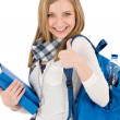 Thumbs up student teenager woman with shoolbag — Stock Photo #5657523
