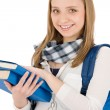 Student teenager woman with schoolbag hold books — Stock Photo #5657530