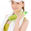 Fitness teenager woman in sportive outfit hold bottle — Stock Photo