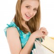 Shopping teenager happy woman in summer dress — Stock Photo