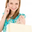 Shopping teenager woman with mobile phone — Stock Photo