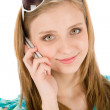 Stock Photo: Teenager woman with mobile phone in summer