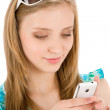 Teenager woman with mobile phone in summer — Stockfoto