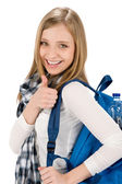 Thumbs up student teenager woman with shoolbag — Stock Photo