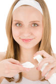 Acne facial care teenager woman apply cream — Stock Photo