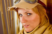 Young woman sunburned face with pilot goggles — Stock Photo