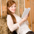 Young romantic woman in barn hold book — Stock Photo