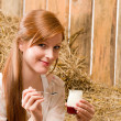 Young healthy woman with natural yogurt country — Stock Photo