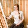 Stock Photo: Red-hair romantic woman in barn painting country