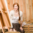 Red-hair romantic woman in barn painting country — Stock Photo #5757087