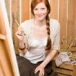 Red-hair romantic woman in barn painting country — Stock Photo #5757092