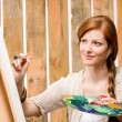 Red-hair romantic woman in barn painting country — Stock Photo