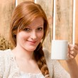 Young romantic woman in barn holding cup — Stock Photo
