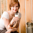 Stock Photo: Young woman drink natural milk in barn