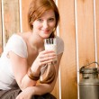 Young woman drink natural milk in barn — Stock Photo #5757125