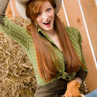 Crazy young cowgirl horse-riding country style — Stock Photo #5757159
