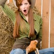 Royalty-Free Stock Photo: Crazy young cowgirl horse-riding country style
