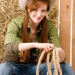 Young cowgirl western country style with rope - Stock Photo