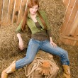 Provocative position young cowgirl on hay — Stock Photo