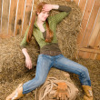 Provocative position young cowgirl on hay — Stock Photo #5757183