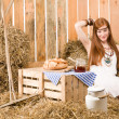 Royalty-Free Stock Photo: Redhead hippie young woman have breakfast in barn