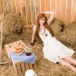 Royalty-Free Stock Photo: Redhead hippie woman have breakfast in barn