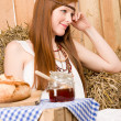 Red-hair young hippie woman breakfast in barn — Stock Photo