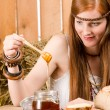 Red-hair young hippie woman have breakfast in barn — Stock Photo