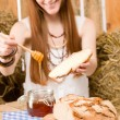Redhead hippie woman have breakfast in barn — Stock Photo