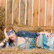 Stock Photo: Young hippie womlying on hay relax