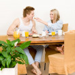 Breakfast happy couple woman feed man toast — Stock Photo