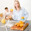 Royalty-Free Stock Photo: Breakfast happy couple make orange juice morning