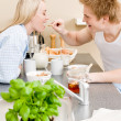 Breakfast happy couple man feed woman cereal — Stock Photo
