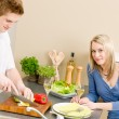 Lunch happy couple prepare salad in kitchen — Stock Photo #5757328