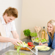 Lunch happy couple cook salad in kitchen — Stock Photo #5757329